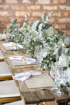 Gorgeous wedding table. Reception. Eucalyptus table runner garland with baby's breath. Wood tables. Barn wedding