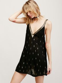 $88 Rising Sun Slip | Embellished sheer mini slip featuring sequin detail and a plunging V-neckline. Effortless, relaxed silhouette.