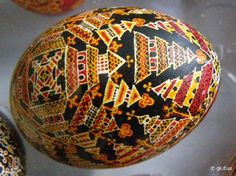 This appears to be a goose egg pysanka from Kosmach.  The pysankar has covered it thickly with traditional wooden churches.