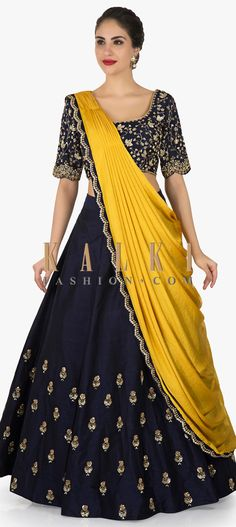 Buy Online from the link below. We ship worldwide (Free Shipping over US$100) Click Anywhere to Tag Navy Blue lehenga with ready pleated dupatta enhanced in cutdana and sequin butti work only on Kalki.Nail the navy blue lehenga with perfection at your bestie's reception. It is featured in silk fabric. The navy blue lehenga is decorated using the cutdana and sequin embroidered work. The ensemble is matched with a ready pleated dupatta in mustard color with embellished borders.