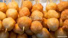 """Download the royalty-free photo """"The close up of Taiwanese fried fish balls on stick at food street market in Taipei, Taiwan."""" created by phasuthorn at the lowest price on Fotolia.com. Browse our cheap image bank online to find the perfect stock photo for your marketing projects!"""