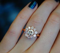 We used customers stones to create a rose gold halo. This is more so a right hand ring than an engagement ring. Good Old Gold - Specializing in Diamonds & Engagement Rings - beautiful diamond rings, earrings, necklaces, bracelets, anything jewelry. www.goodoldgold.com