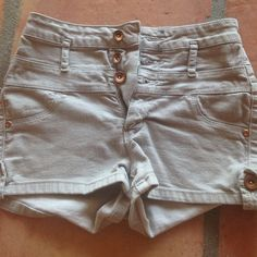 High wasted shorts Grey 3 buttoned high wasted shorts. Gently worn. Very stylish with a crop top. Selling because they are too small for me ! Refuge Shorts Jean Shorts