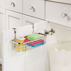 Keeping sponges and scrub brushes out of sight will make your sink appear cleaner.