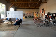 """While the duo masterminded the design of the """"house,"""" they turned the spotlight on the diverse design district where the pop-up took place, including furnishings from Helms retailers like HD Buttercup, Room & Board, and Rejuvenation. She notes, """"We used pieces from every store on the property—which included ultra-modern furnishings, antique rugs, outdoor appliances, and mid-century modern lighting—with art that we obtained through a wonderful partnership with Saatchi."""""""