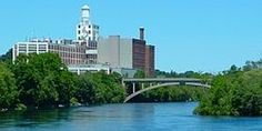 Peterborough, Ontario - Wikipedia, the free encyclopedia = The Quaker Oats factory on the edge of the Otonabee River, with the Hunter Street bridge Peterborough Ontario, Hunter Street, Willis Tower, Bridge, Canada, River, City, Places, Memories