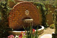 Looking at this feels like I'm on a vacation in Mexico. . . The sun, this gorgeously detailed fountain, and the plantings surrounding it are flawless. Design by http://www.azulverde.com .
