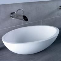 DADO Europe - manufacturers of DADOquartz Stone Bathroomware - durable and uniquely crafted, freestanding stone baths, basins, taps, toilets and vanities.