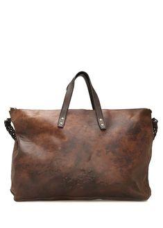 Omuz askılı, kulplu, düz renk çanta. Fermuar kapatmalı, 1 adet iç bölmeli. Askı yükseklik: 50 cm - Kulp yükseklik: 25 cm. 65x50x10 cm