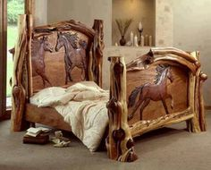 Cabin bed made from logs and sculptured wood.