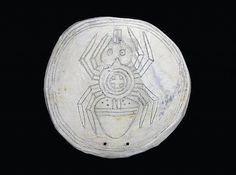 Cherokee native shell gorget with 'Water spider' motif.  The spider was believed to carry the first fire to humans. Mississippian era 1000 - 1600 AD, Tennessee, USA