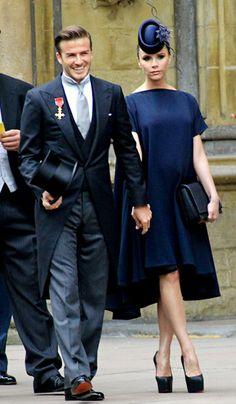 Victoria Beckham - her custom-designed navy dress & Philip Treacy pillbox hat, Christian Louboutin pumps... worn on Prince William & Kate Middleton's wedding day - April 29, 2011