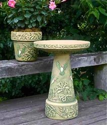 Neat bird bath for flower bed