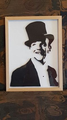 Fred Astaire.  Made out of pieces of mdf. Painted and mounted in a frame.