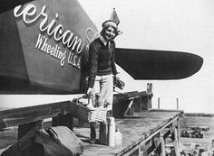 """Ruth Elder and her Stinson monoplane, Oct., 1927. She named her plane """"American Girl"""" and hoped to be the first woman to fly solo over the Atlantic."""