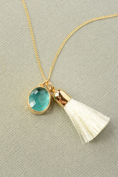 A personal favorite from my Etsy shop https://www.etsy.com/listing/465095633/ivory-tassel-turquoise-sea-glass-gem