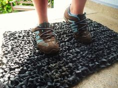 Pretty neat to see that someone crocheted(!) bicycle tire inner tube pieces -- made a door mat out of them.