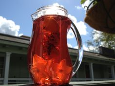 Hibiscus Starfruit Orange Water fruit infused water - Hibiscus tea is a bit more creative fruit infusion. The flower petal turns your water a rich pink color and has a taste that complements fruit perfectly. You can find hibiscus at health co-ops, Whole Foods, or online.  Recipe for an 80 oz infused water pitcher: 2 teaspoons loose hibiscus tea (or two bags) + 3 slices organic orange + 4 slices starfruit. Combine the orange slices and tea in your pitcher's Infuser capsule but leave the…
