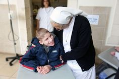 A sister speaks with a resident of the Maison du Sacre Coeur, a Catholic institution run by the Daughters of Charity that serves the needs of specially cha Daughters Of Charity, Visit Israel, Branches, Catholic, Presidents, December, Sisters, Challenges, Children