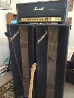 I believe this looks like a 1967 Extremely Rare Black Flag Marshall Super P.A. 50 watt Head with a pair of Marshall P.A. Column Speakers.