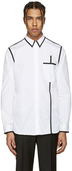 Long sleeve poplin shirt in white. Contrast piping in black throughout. Spread collar. Concealed button closure at front. Patch pocket at chest. Single-button barrel cuffs. Tonal stitching.
