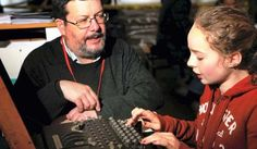 GCHQ staff explain the Enigma machine to visitors at Mosi during 2013 event