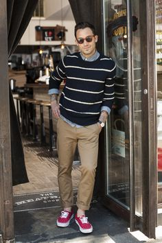 Chambray Shirt, Striped Cotton Sweater, Fitted Chinos, and Red Sneakers. Men's Spring/Summer Street Style.