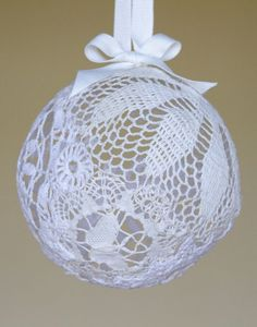 DIY | Doily Lantern.  There are lots of similar projects making the rounds, but I love the look of this one.  These doily orbs would look great hanging or displayed in a bowl or on a shelf with other objects.
