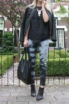 street style 90s grunge tie dye jeans with quilted leather bomber jacket