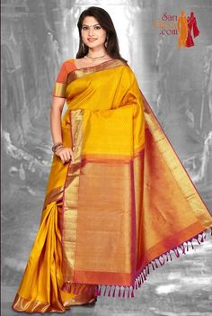 Yellow color body with mustard color border #kanchipuramsarees visit: http://www.saridhoti.com