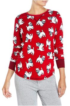 """Soft, cozy velour red lounge or pajama top with an adorable white dog all over print. The dog wears a blue collar with a bow. The top has black contrasting stripes at the cuff and black stitching a the neckline and shoulders.    Measures 28"""" down the center back (size medium).    Red Velour Top by The Dressing Room. Clothing - Lingerie & Sleepwear - Sleepwear California"""