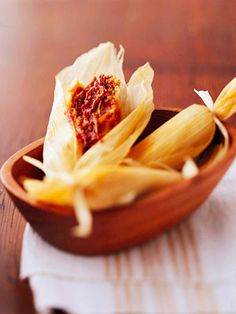 These mini Mexican tamales make perfect appetizers! Stuff with pork filling for a pork tamale, or cheese for vegetarian tamales. Mix and match fillings for tamales to fit everyone's taste! Mexican Dinner Recipes, Mexican Cooking, Tortillas, Pork Recipes, Cooking Recipes, Jelly Recipes, Cooking Tips, Recipies, How To Make Tamales