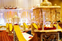 For their traditional Indian wedding ceremony, this bride and groom opt for an opulent stage and champagne-colored details!