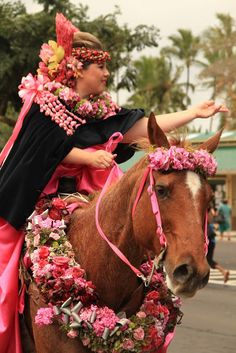 Pau riders with beautiful lei garlands on horse and rider.