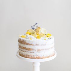 Lavender and lemon curd chiffon cake, decorated with dried lemon slices, fresh lavender, and edible flower petals. Make your own with my recipe in the citrus issue of @hartandhoney. Pick up a copy at hartandhoney.com photo by @lilyglass