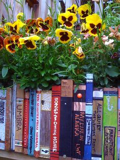 wood painted to look like books makes a stunningly wonderful flower planter.