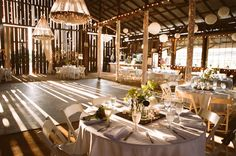 Who says a dirt floor can't work for a wedding reception? This image captures the rustic aesthetic to a tee...