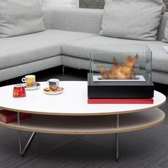 The stylish Bio-Blaze Table-top Bio-Ethanol Fireplace Lisboa Black BB-LIS-B is the perfect portable fireplace for indoor and outdoor use. Chose between the available colors for the top and base and set up your own 15-inch table-top fireplace to coordinate with your interior. Tabletop Fireplaces, Bioethanol Fireplace, Fireplace Mantels, Portable Fireplace, Mantel Shelf, Patio Heater, Electric Fireplace, Indoor, Bb