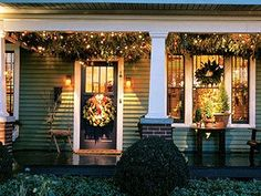 Evergreen clippings + lights + ornaments turn a porch roof into one big Christmas tree Big Christmas Tree, Christmas House Lights, Cottage Christmas, Wooden Christmas Tree Decorations, Merry Christmas, Cottage Porch, Cozy Cottage, Cottage Style, Cottage Living