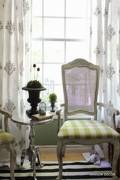 A garden inspiration was the theme for this small home office. Anything from a garden can be used inside, so think garden style and have some fun!  Our color palette was black, white and green.  Using these colors helps tie everything together. Drapery panels in a boho black and white pattern from HomeGoods and a silver pedestal table add modern touches to mix it up with the vintage garden decor, urns and moss balls. Sponsored by HomeGoods.
