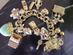 Amazing Heavy 14k,18k Charm Bracelet.. Many working, moving pieces, jade, ruby