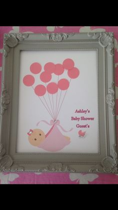 £1 frame with printed clip art, pink circles punched out for guests to sign at the shower,a nice keepsake for the nursery. glass goes on when complete.