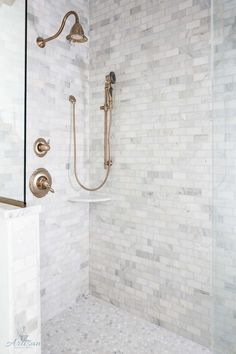 Shower Tile Combination: Marble subway tile on walls and marble penny tile on the floor.