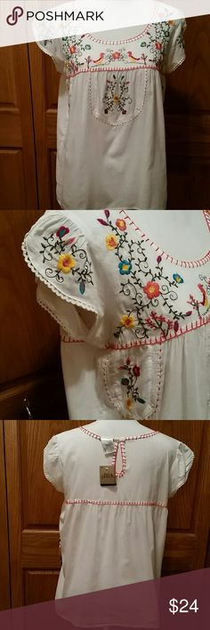 NWT Bila Lightweight Peasant Top So countryside chic! Lightweight 100% cotton with colorful embroidery. Loose fitting, keyhole back neckline and petal sleeves finished off with lace trim. Extra button in tag casing. Breastline across laying flat measures 19.5 and shoulder to bottom of top measures 25.25 so pretty ! Habdwash cold for best results. ;)  Bila Tops Blouses