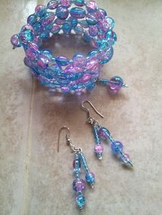 pink/turquoise colored wrap bracelet/earrings-nancy: http://www.outbid.com/auctions/13449-no-kid-hungry-charity-auction#59