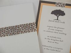 wedding invitation with leopard print or zebra print detail.  Pocket fold envelopment with african theme