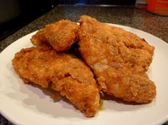 BAKED FRIED CHICKEN! This is a family favorite and tastes just like KFC! The good part....no skin & no frying! These Chicken tenders are baked and simply divine! A sure family pleaser!.