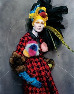 there is so much here to study! amazing jarring colorover the top headwear,makeup that hypnotizes!!!