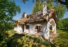 Szigliget, Hungary --a far cry from isolated, stern Namaire, Ro's childhood home though.probably not so well kept these days My House In Budapest, Mediterranean Style Homes, Thatched Roof, Natural Building, Cottage Homes, Traditional House, Countryside, Building A House, Pergola
