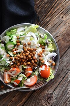 An exciting salad with falafel spiced, roasted chickpeas and a generous tahini dressing. Add seasonal vegetables to make it an easy warm-weather meal.